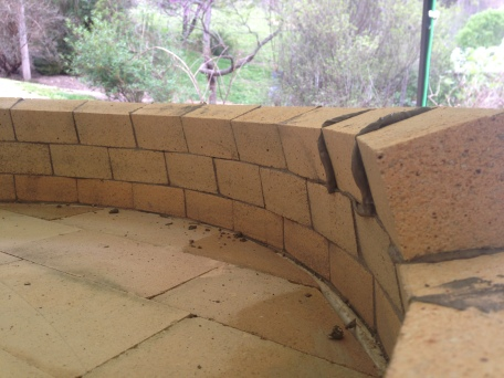 tapered bricks naturally give tight bed joints, compound miter cuts allow for tight head joints